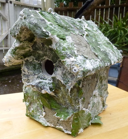Birdhouse with concrete leaves